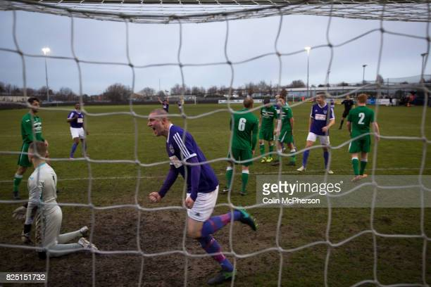 Home players celebrating their team's second goal at the Delta Taxis Stadium Bootle Merseyside as City of Liverpool hosted Holker Old Boys in a North...