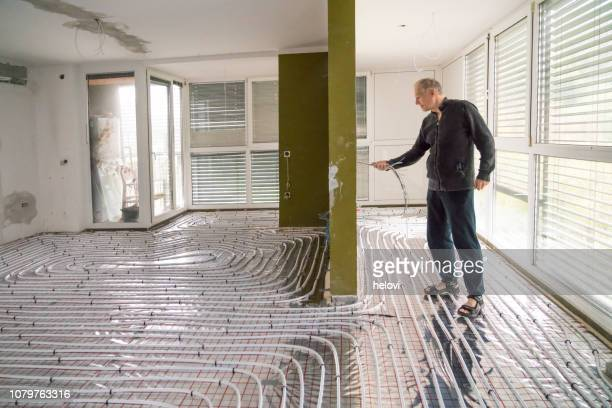 home renovation with underfloor heating - heat stock pictures, royalty-free photos & images