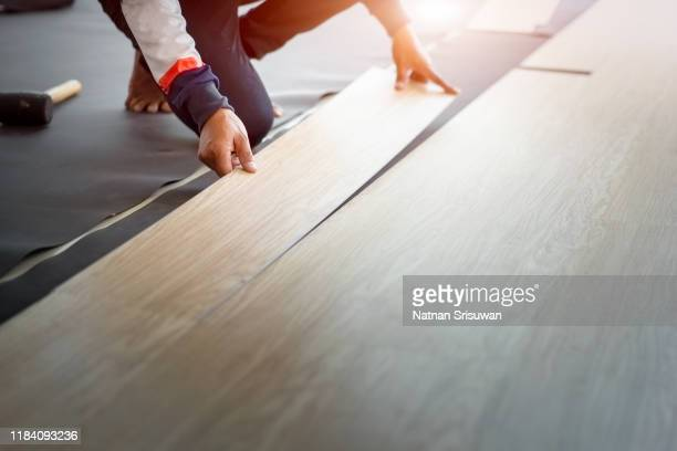 home renovation with vinyl laminate flooring. - installing stock pictures, royalty-free photos & images