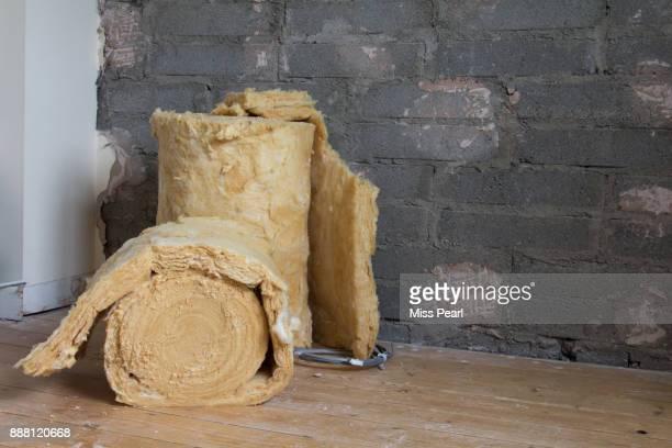 home renovations showing with rolls of insulation - isoliert stock-fotos und bilder
