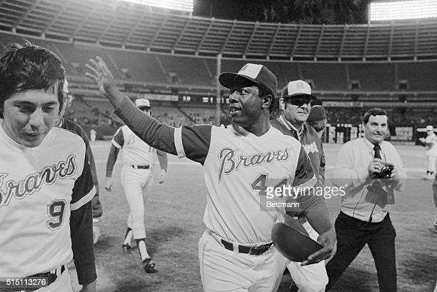 Home run champ Hank Aaron waves to the crowd here, after a season ending home run in the 7th inning. The homer was his 733'd and the 20th of the...