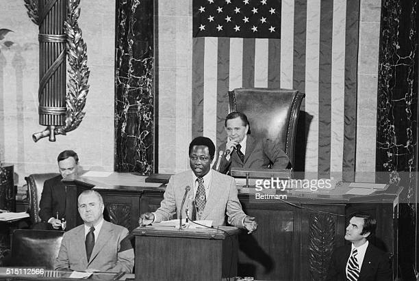 Home run King Hank Aaron of the Atlanta Braves takes part in Flag Day Ceremonies on the floor of the House of Representatives In the background is...