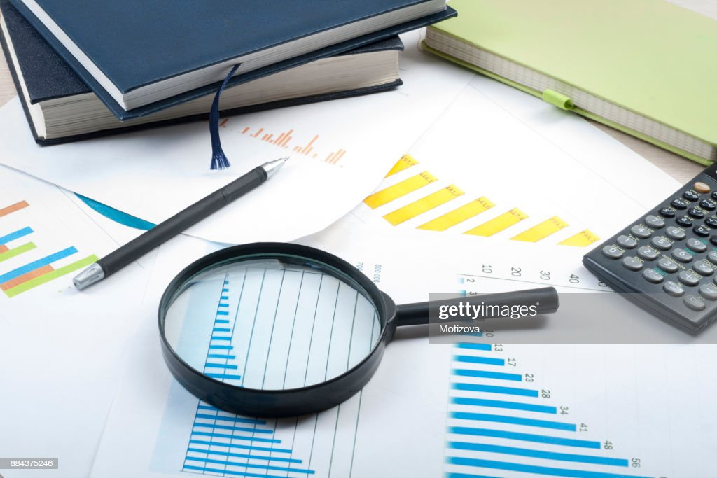 home savings budget concept chart pen calculator and magnifying