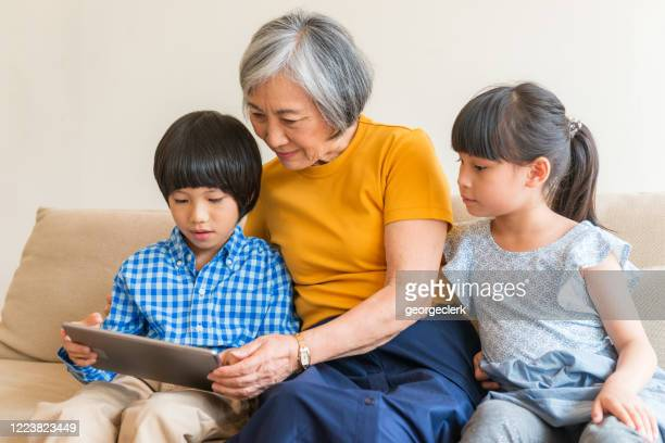 home schooling with grandmother - taiwan stock pictures, royalty-free photos & images