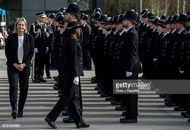 Home Secretary Amber Rudd and Superintendant Robyn Williams inspect new recruits to the Metropolitan Police Service taking part in their 'Passing Out...