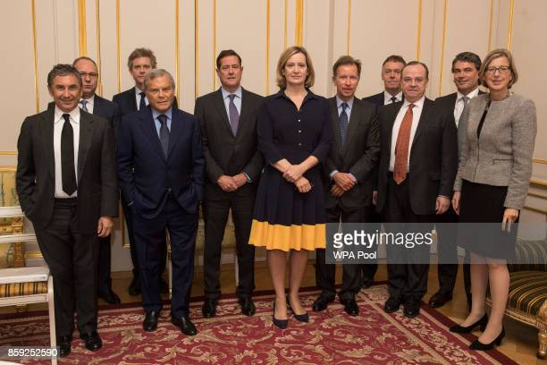Home Secretary Amber Rudd poses with Burberry CEO Marco Gobbetti Anglo American CEO Mark Cutifani ABF CEO George Weston WPP CEO Sir Martin Sorrell...