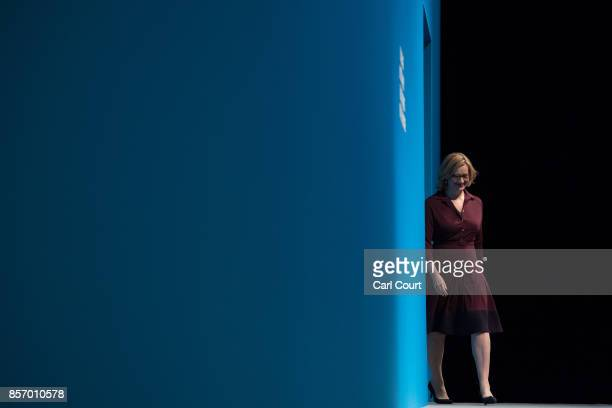 Home Secretary Amber Rudd walks to the podium to deliver her keynote speech on day three of the Conservative Party Conference at Manchester Central...