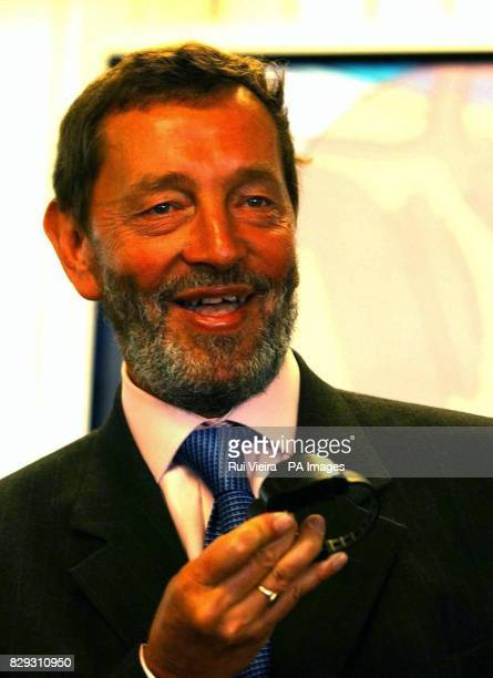 Home Secretary David Blunkett holds an ankle device during the launch of a satellite tracking system that will monitor movements of paedophiles and...