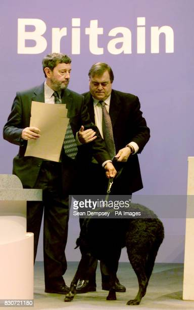 Home Secretary David Blunkett is guided to the rostrum by Deputy Leader John Prescott as he prepares to address the delegates on the final day of the...