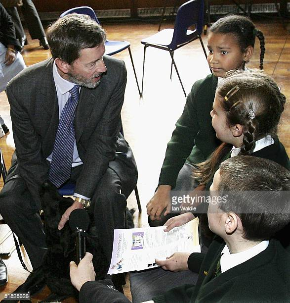 Home Secretary David Blunkett meets students from Bishop Thomas Grant School as he attends the launch of a video intended to educate children away...