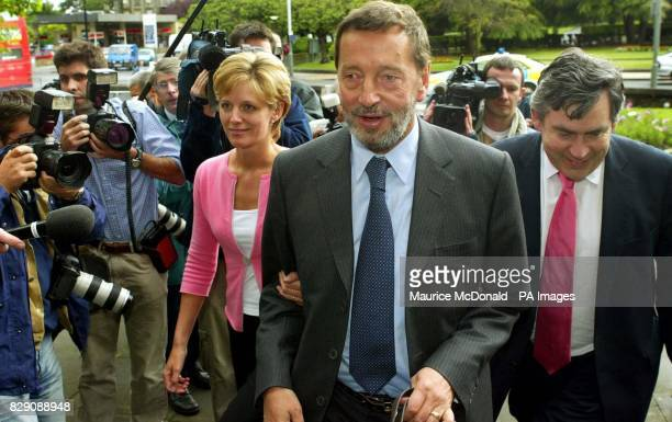 Home Secretary David Blunkett with the Chancellor Gordon Brown and Julia Ogilvy the chair of Project Scotland the national volunteering scheme which...