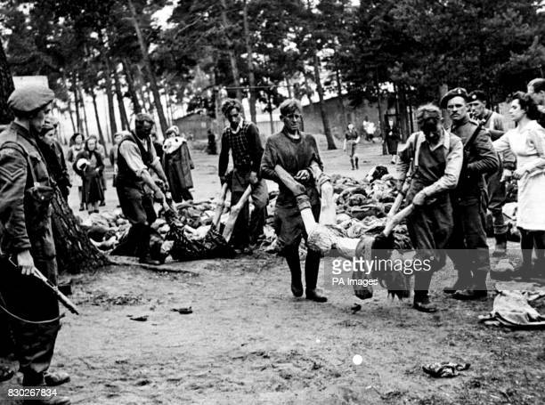 ARE FORCED BY ALLIED TROOPS TO CARRY THE DEAD BODIES OF THEIR VICTIMS TO LORRIES PHOTO PART OF PA SECOND WORLD WAR COLLECTION * Home Secretary Jack...