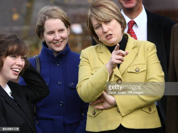 Home Secretary Jacqui Smith stands with Hannah Cooper from Wolverhampton and Labour's prospective candidate for the city Emma Reynolds viewing an...
