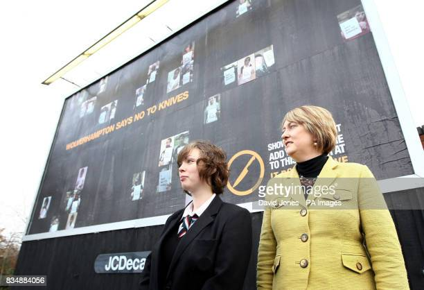 Home Secretary Jacqui Smith stands with Hannah Cooper from Wolverhampton in front of an antiknife crime billboard bearing Hannah's winning antiknife...
