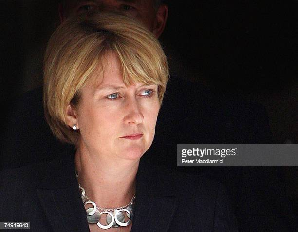 Home Secretary Jacqui Smith walks out of Number 10 Downing Street to talk to reporters on June 29, 2007 in London. Earlier police carried out a...