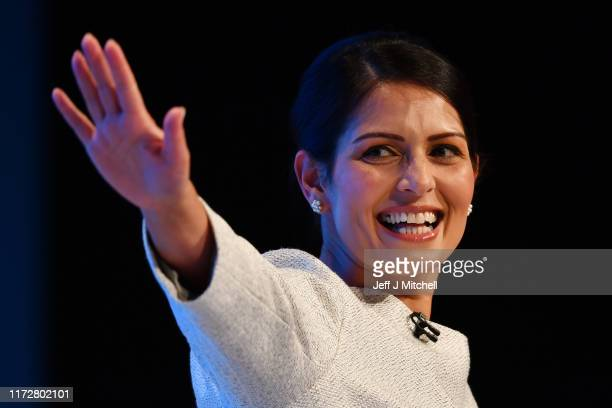 Home Secretary, Priti Patel addresses the delegates on the third day of the Conservative Party Conference at Manchester Central on October 1, 2019 in...