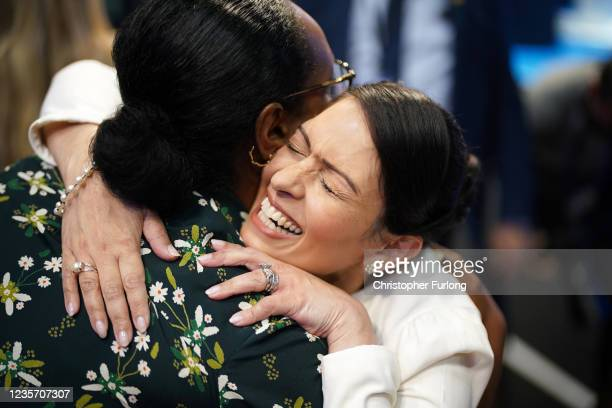 Home Secretary Priti Patel embraces Nimco Ali, co-founder and CEO of The Five Foundation, after delivering her keynote speech on day three of the...