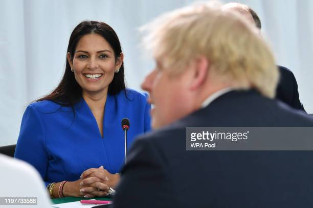 Home Secretary Priti Patel looks on Britain's Prime Minister Boris Johnson chairs a cabinet meeting at the National Glass Centre at the University of...