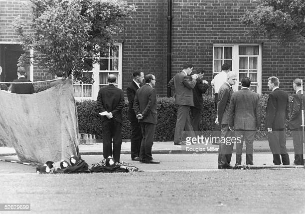Home Secretary Roy Jenkins visits the crime scene the day after three policemen were shot to death in Braybrook Street, 13th August 1966. Constable...