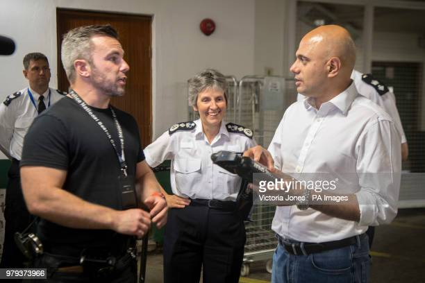 Home Secretary Sajid Javid and Metropolitan Police Commissioner Cressida Dick are shown a DNA spray for bicycles during a visit to Islington Police...