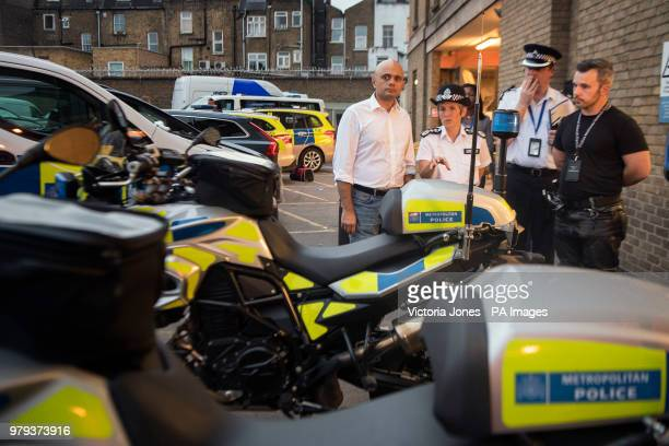 Home Secretary Sajid Javid talks with Metropolitan Police Commissioner Cressida Dick during a visit to Islington Police Station in London ahead of...