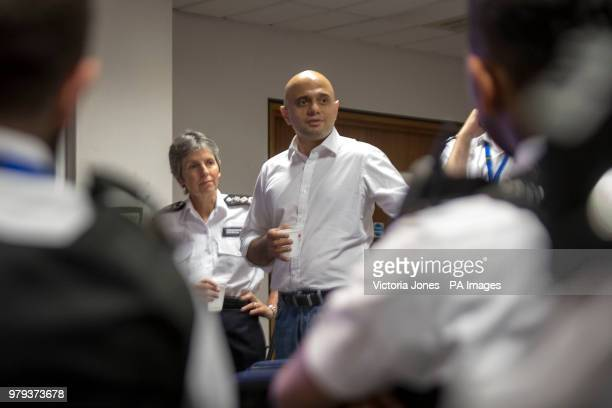 Home Secretary Sajid Javid watched by Metropolitan Police Commissioner Cressida Dick talks to officers during a visit to Islington Police Station in...