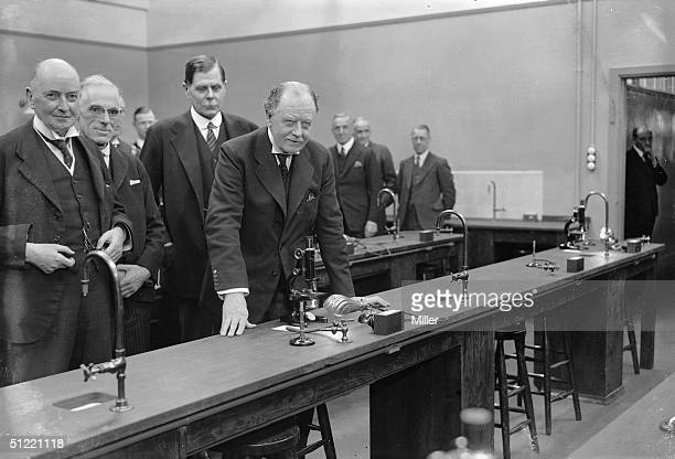 Home Secretary Sir John Gilmour opens the Metropolitan Police laboratory based at Hendon London Lord Trenchard Commissioner of Police for London is...