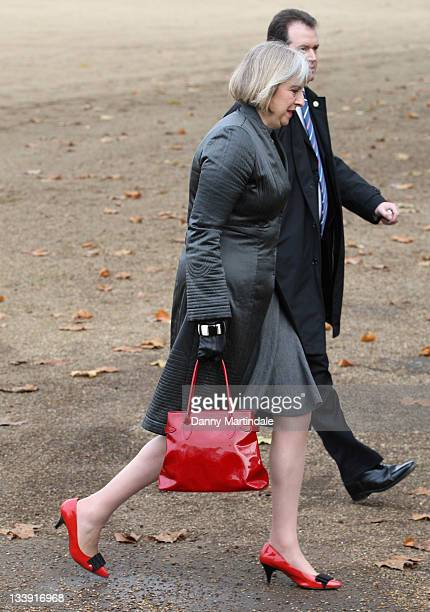 Home Secretary Teresa May MP walks across Horse Guards Parade after joining HM Queen Elizabeth II and Prince Philip Duke of Edinburgh for the...