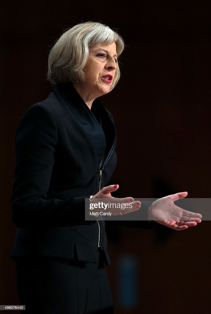 Home Secretary Theresa May addresses the Conservative Party Conference in the main hall of the ICC Birmingham on on September 30, 2014 in Birmingham, England. The third day of conference will see speeches on home affairs and justice.