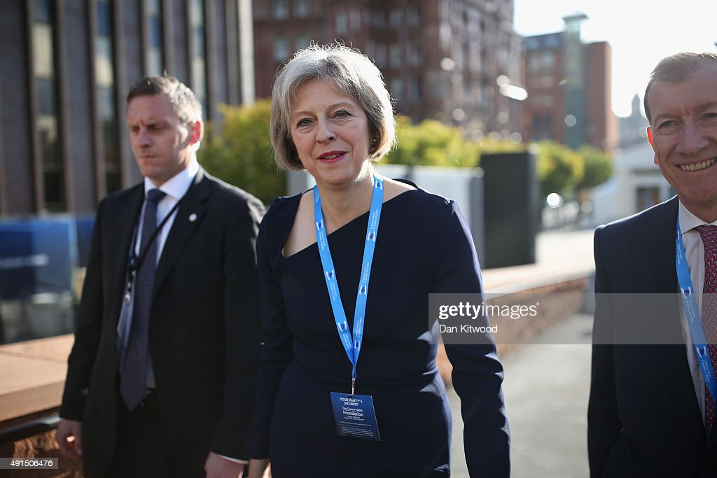 Home Secretary Theresa May arrives on the third day of the Conservative party conference on October 6, 2015 in Manchester, England. Home Secretary Theresa May is due to address delegates on day three of the Conservative Party conference and will say the UK needs to have an immigration limit to help create a 'cohesive, integrated society'.