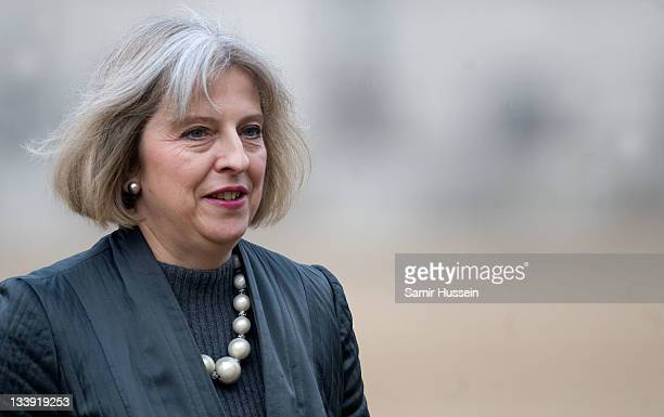 Home Secretary Theresa May walks across Horse Guards Parade after joining Queen Elizabeth II and Prince Philip Duke of Edinburgh for the official...