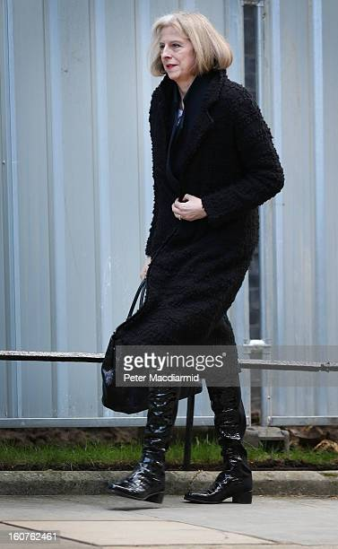 Home Secretary Theresa May walks into Downing Street to attend a security meeting with US Vice President Joe Biden on February 5 2013 in London...
