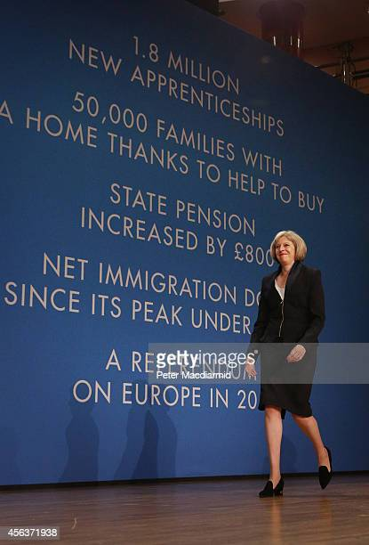Home Secretary Theresa May walks on to the stage to address the Conservative party conference on September 30 2014 in Birmingham England The third...