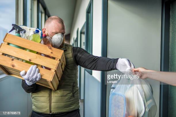 home shopping delivery during virus outbreak - essential workers stock pictures, royalty-free photos & images