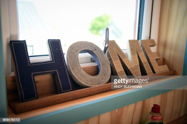 A Home sign inside a NestHouse is pictured during the launch of the Social Bite Village project in Granton Edinburgh in Scotland on May 17 2018 The...