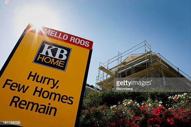 Home sign stands in front of a house under construction at the Whisler Ridge housing community in Lake Forest, California, U.S., on Monday, Sept. 23,...