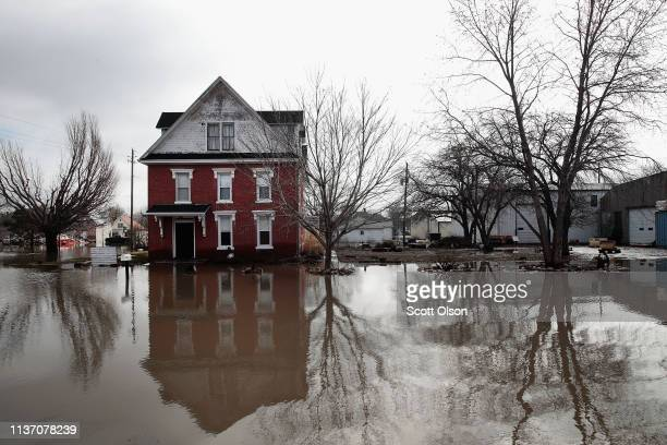 A home sits in flood water on March 20 2019 in Hamburg Iowa Although flood water in the town has started to recede many homes and businesses remain...
