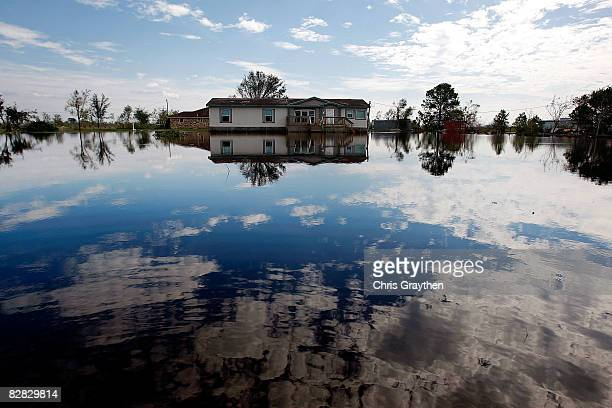 A home sits surrounded by water on a flooded farm after Hurricane Ike hit September 15 2008 in Winnie Texas Ike caused extensive damage along the...