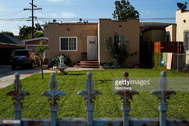 A home stands in Compton California US on Monday July 6 2015 It can be a letdown for LA Hood Life Hip Hop Tours customers passing the Welcome to...