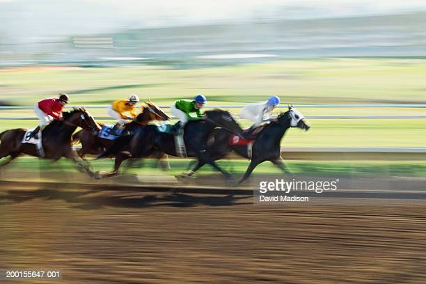 home stretch of horse race (digital enhancement) - horse racing stock pictures, royalty-free photos & images