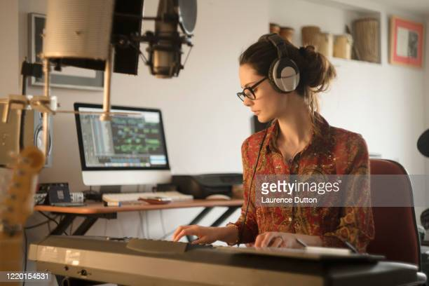 home studio player woman - singer songwriter stock pictures, royalty-free photos & images