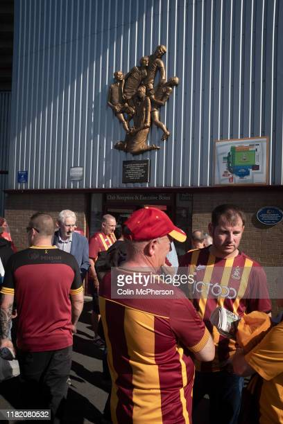 Home supporters standing below a memorial to the 1985 fire at the ground before Bradford City played Carlisle United in a Skybet League 2 fixture at...