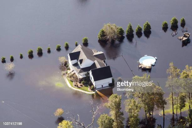 A home surrounded by floodwater is seen in this aerial photograph taken above Kinston North Carolina US on Friday Sept 21 2018 Record floods cover...