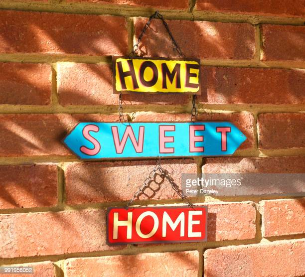 home sweet home hanging sign - home sweet home stock pictures, royalty-free photos & images