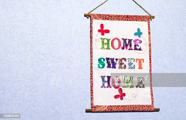 Home sweet home sign hanging on a wall