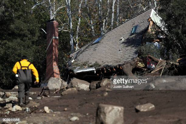 A home that was destroyed by a mudslide sits on its side in a field of debris on January 11 2018 in Montecito California 17 people have died and...
