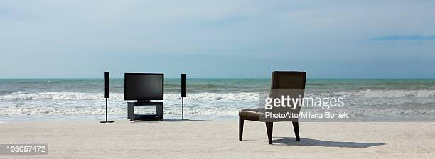 Home theater and chair on beach