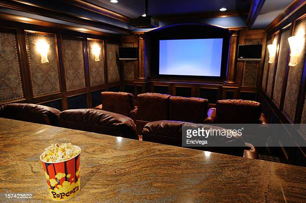 home theater with focus on popcorn - entertainment center stock pictures, royalty-free photos & images