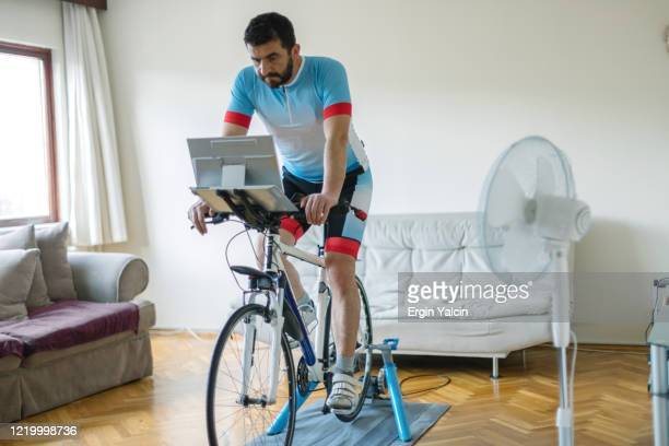 home trainer with exercise bike - peloton stock pictures, royalty-free photos & images