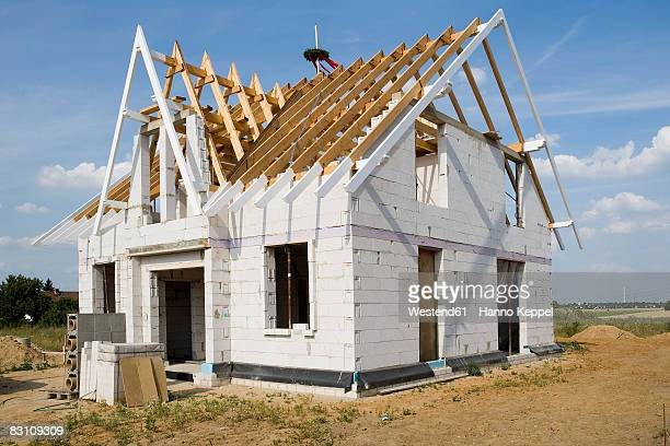 Germany, wooden framework of roof of house under construction